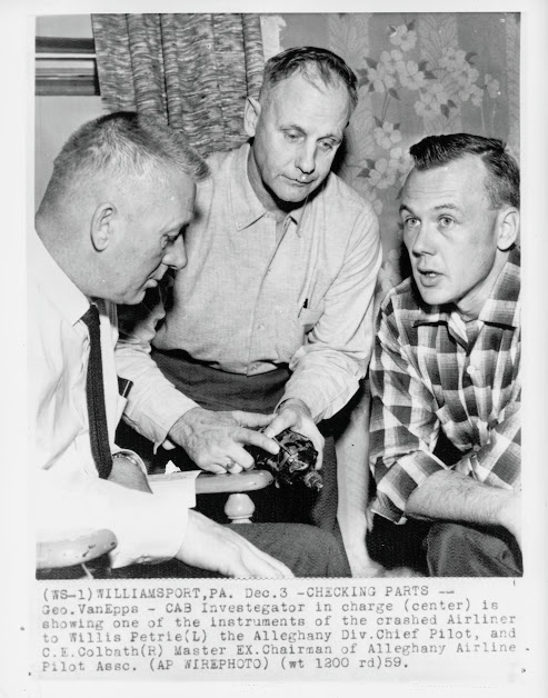 CAB investigators looking at the Fluxgate Compass. This instrument was believed to be one of the reasons the plane flew off coarse and hit Bald Eagle Mountain. Photo courtesy of the Williamsport Sun Gazette archives.