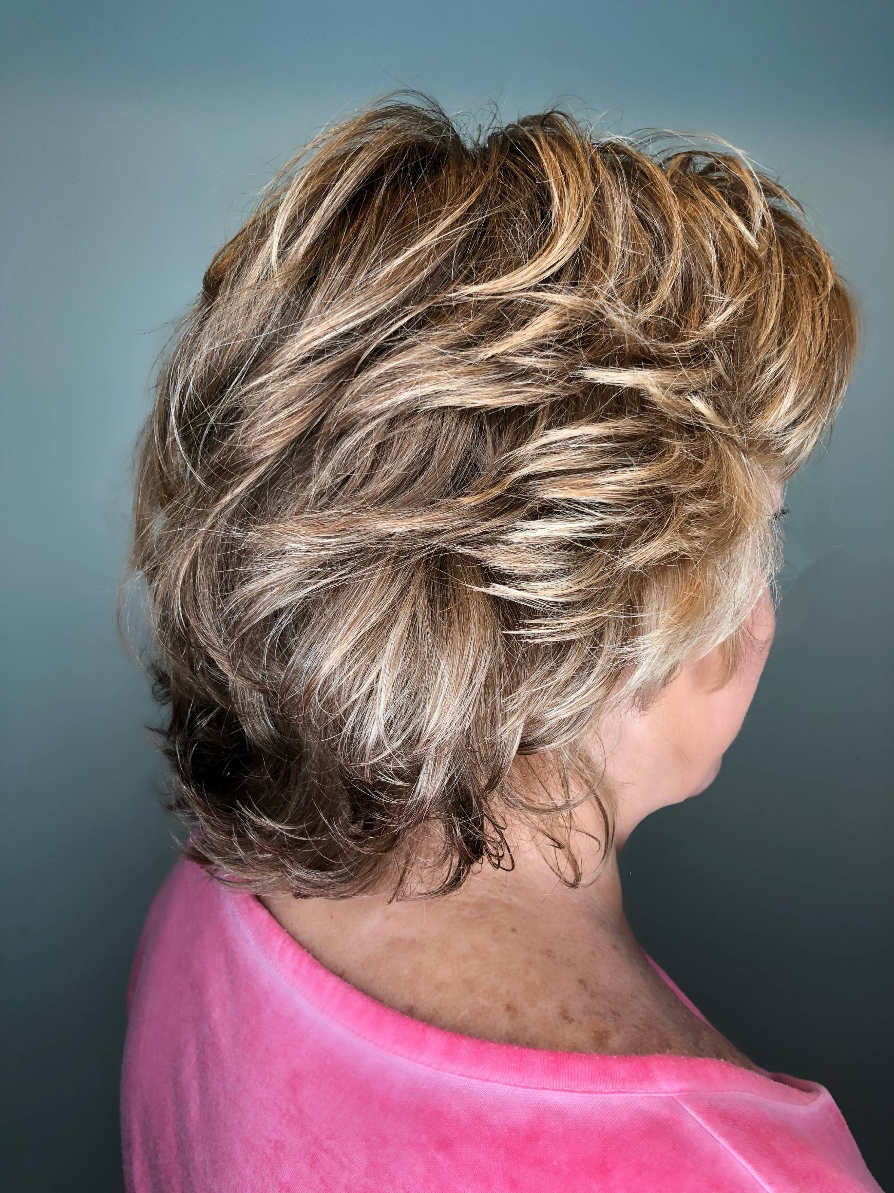 Organic perm with blonde highlights