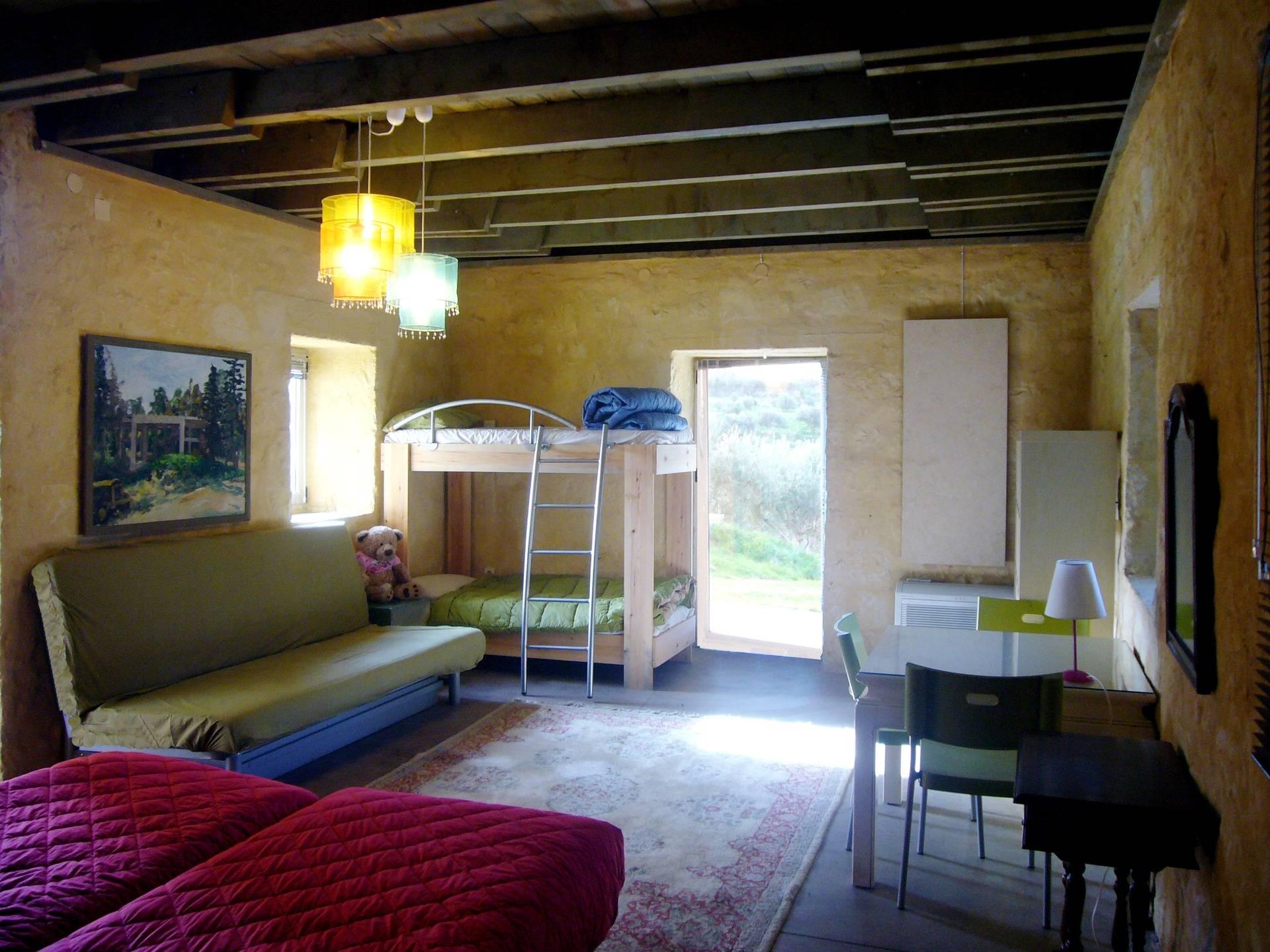 ground floor: big bedroom, sofa and bunk bed