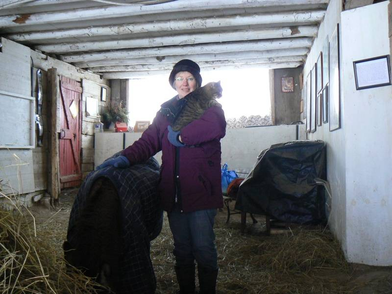 Susan with Gypsy cat and 44 year old Jack the donkey
