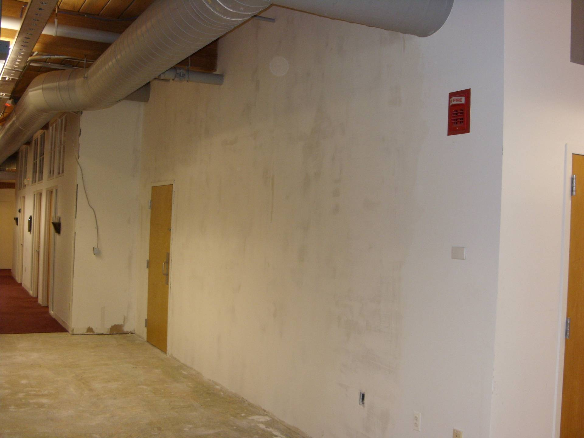 After Image 3: Opened up Hallway with Storage Room to the right