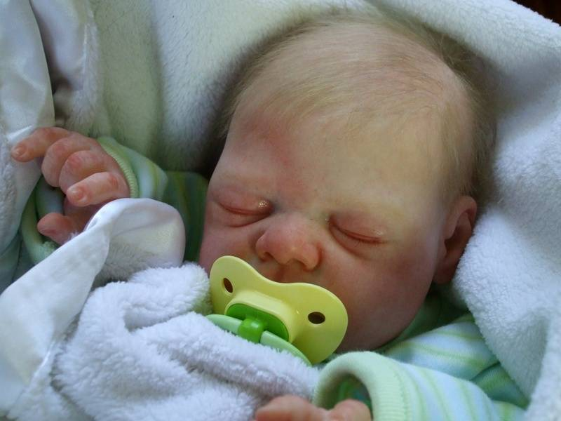 His pacifier transforms him into a little angel