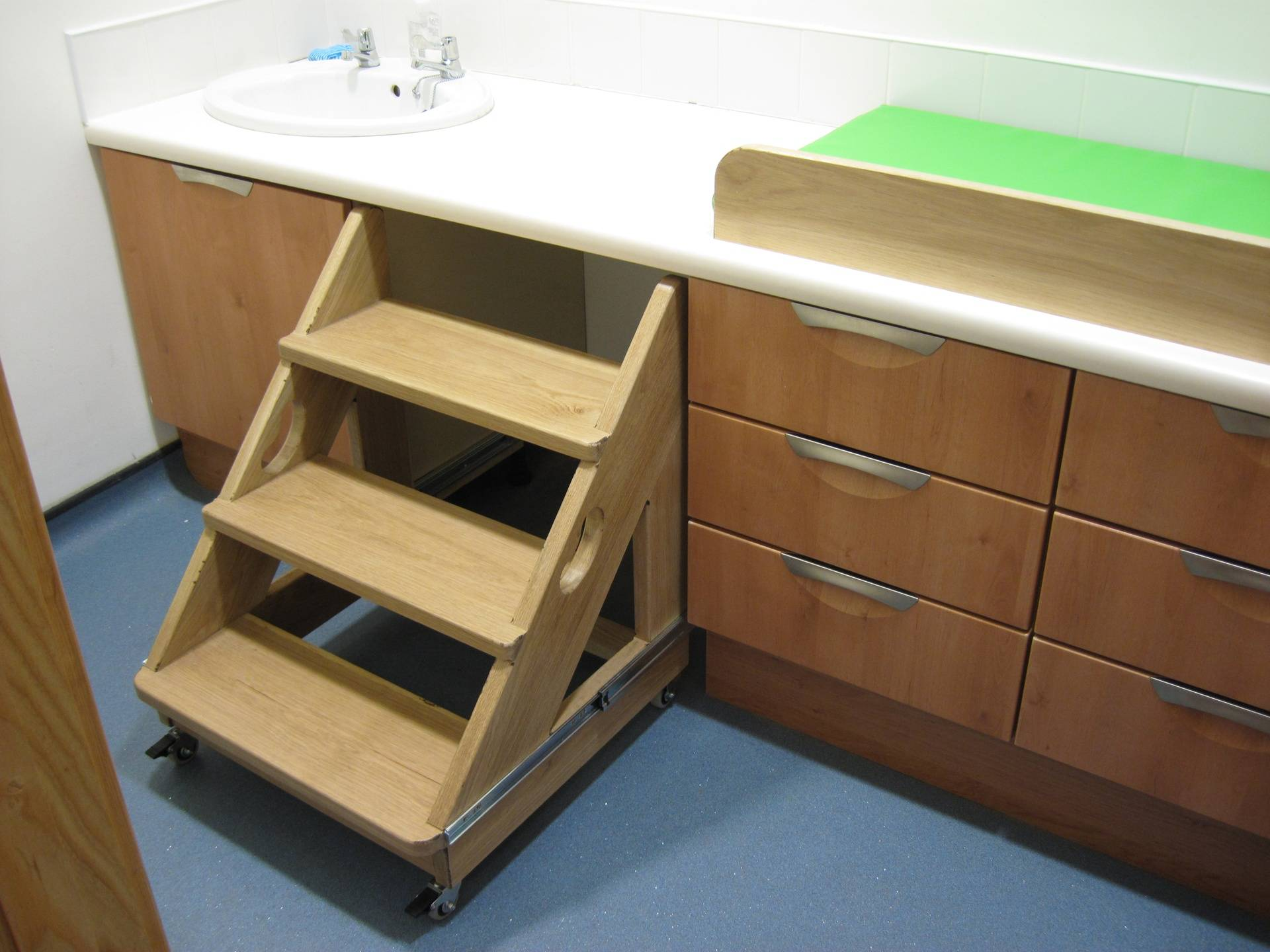 Changing table with wooden steps