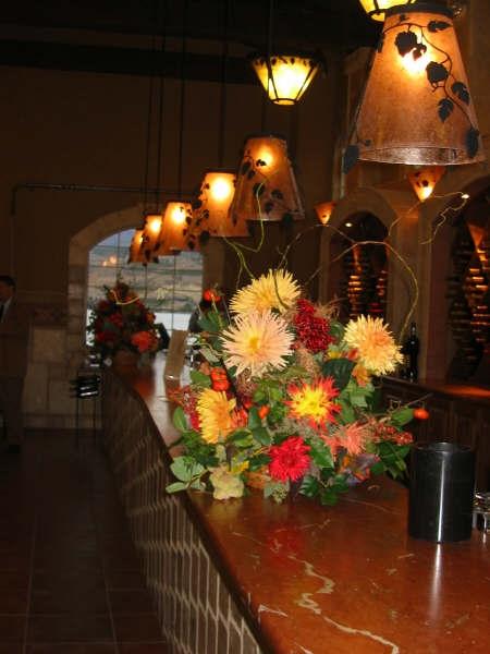 view down the tasting bar w/ arrangements