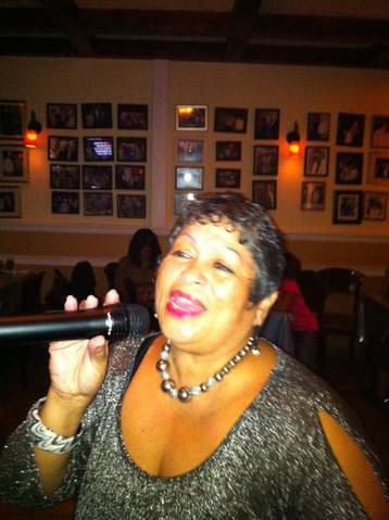 Norma doin it up for the crowd at Joe's Place Friday Night Karaoke Fiesta!