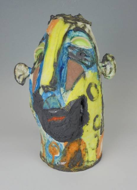 Mary Jones Ceramics.  Happy in the garage.