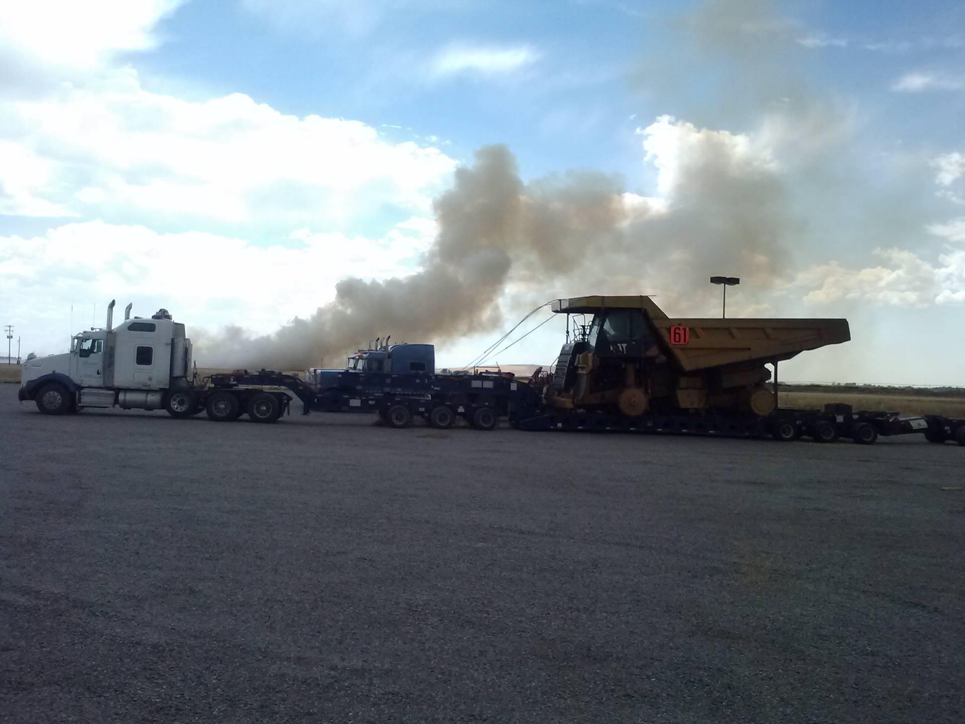 Field on fire after a tornado.