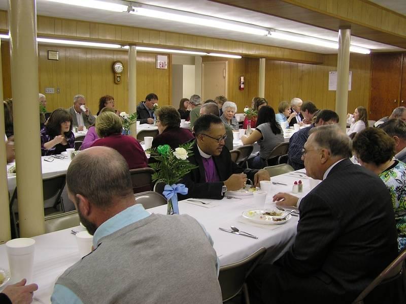 Bishop Holloway enjoys his meal!