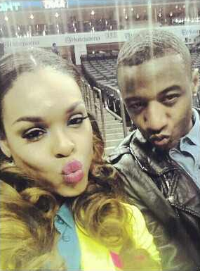 """Demetria McKinney & Victor At The """"Women's Championship Game"""" In North Carolina, on March 2, 2013"""