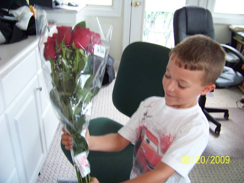 Peyton presenting a dozen roses