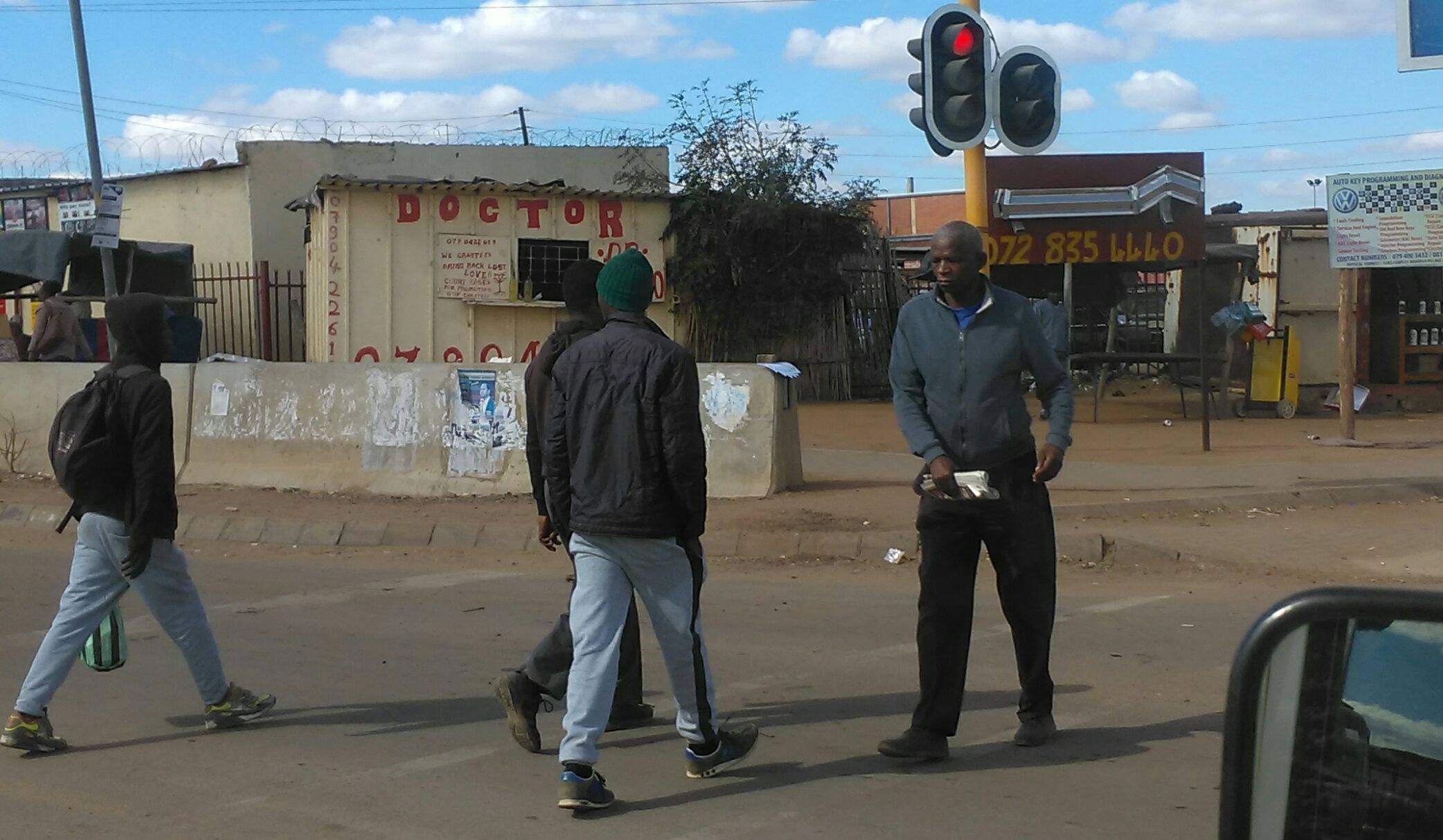 back driving thru parts of Jo'burg, note the sign on the building... thats their doctor clinic