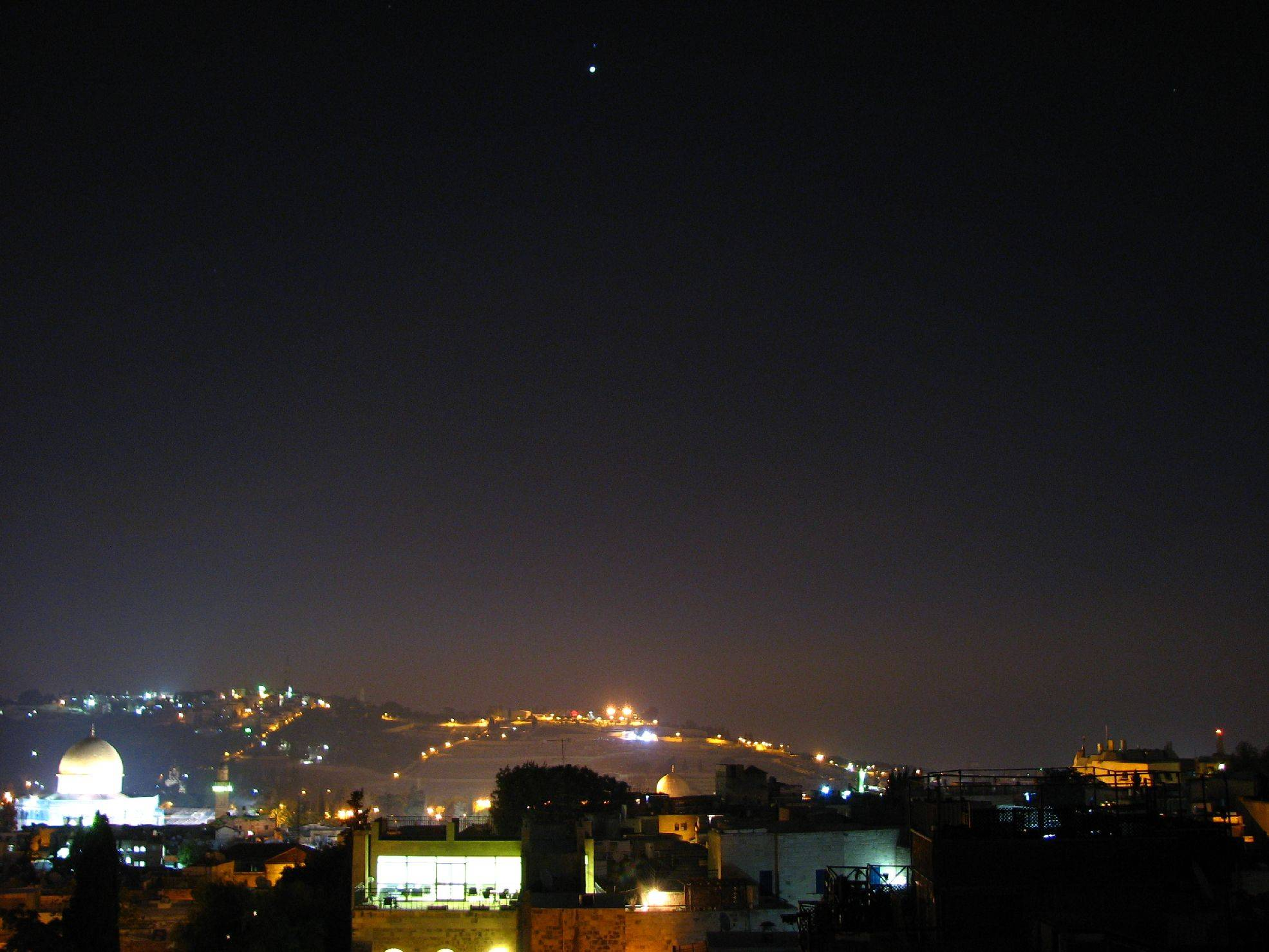 City at Night With Rare Star