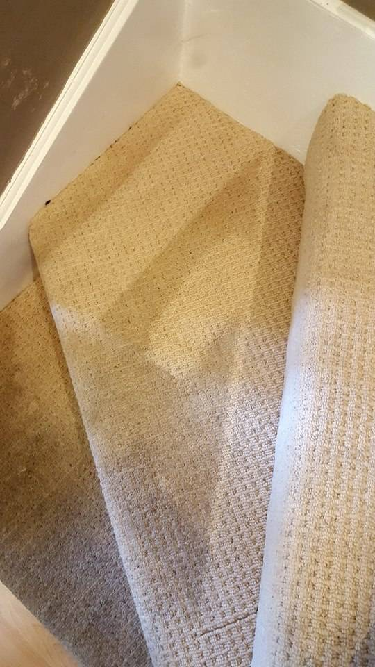 Stairs during cleaning showing brighter clean patch