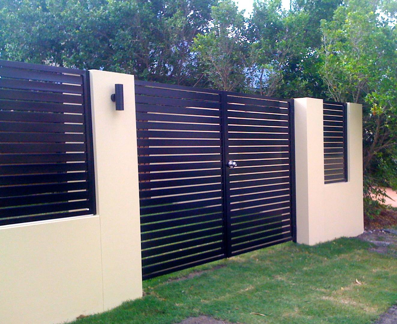 Double gates in a front fence.