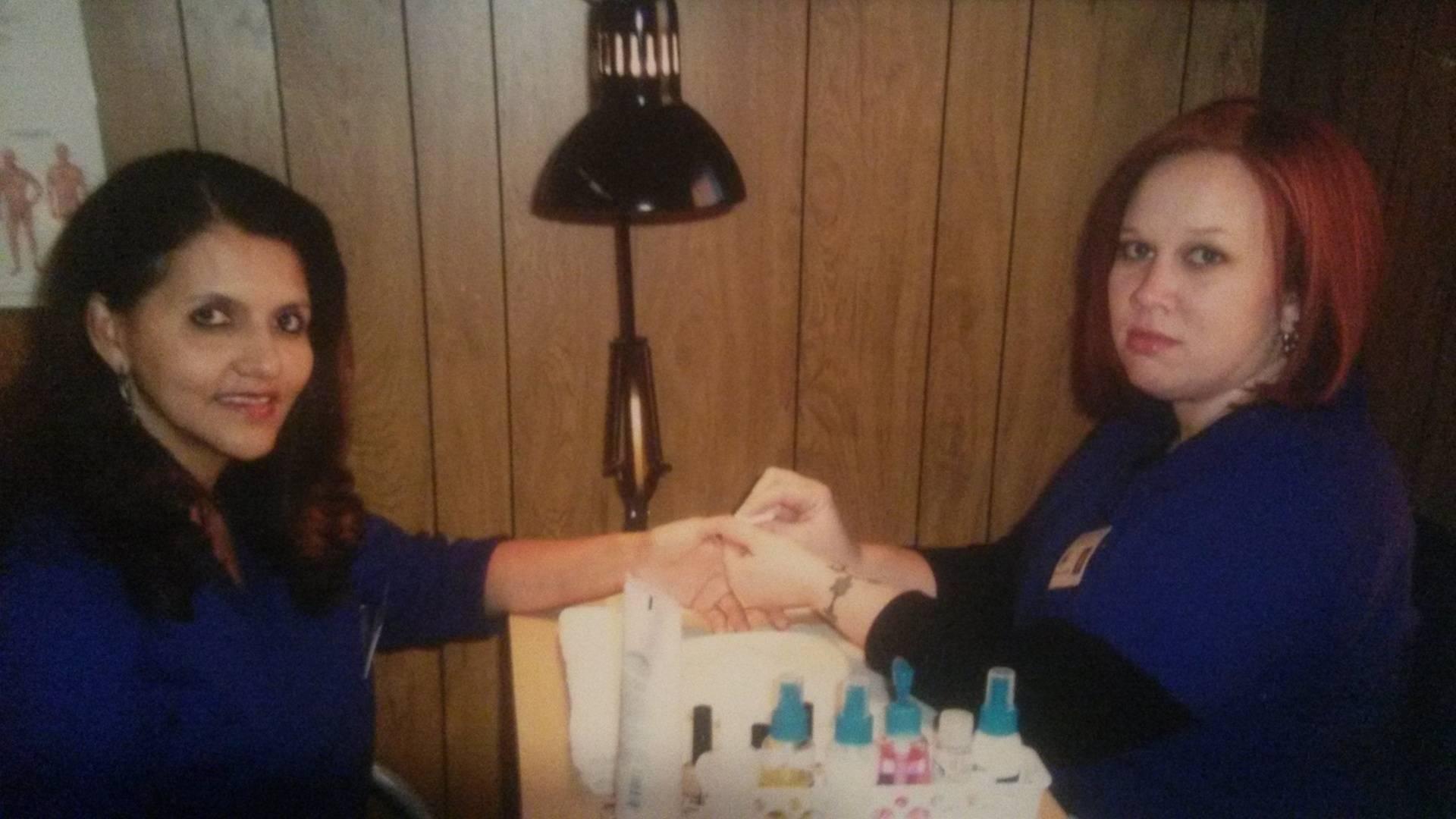 Student providing a manicure