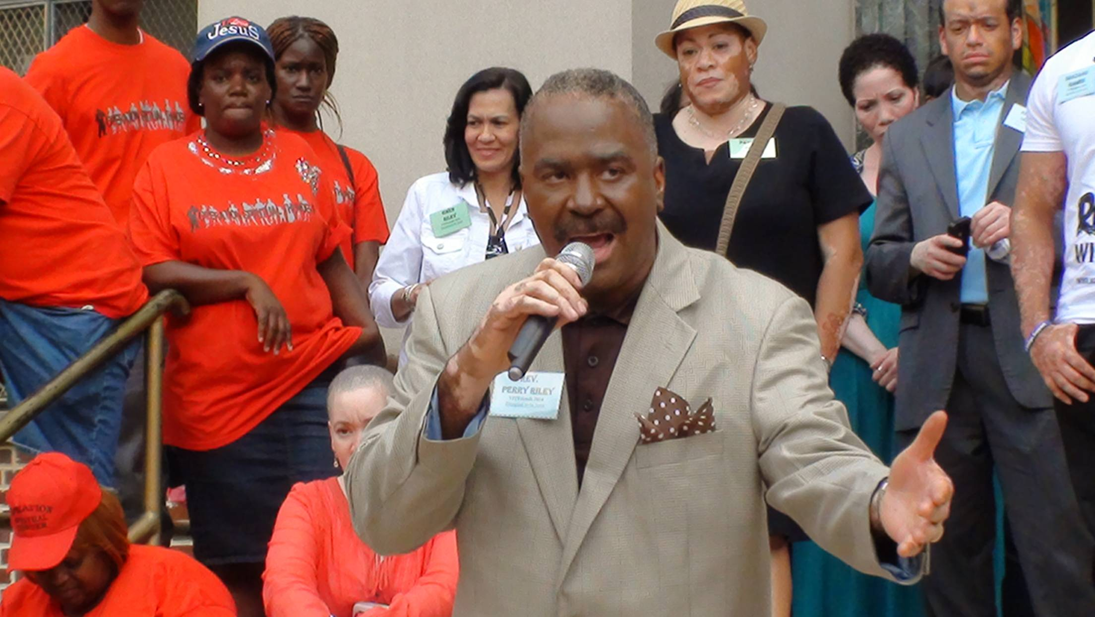 Rev Perry was presented on the steps of the church to the neighborhood
