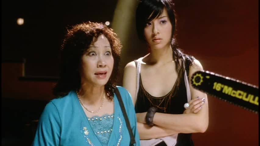 Yuen Qiu as Auntie Fei with Nipple Twister