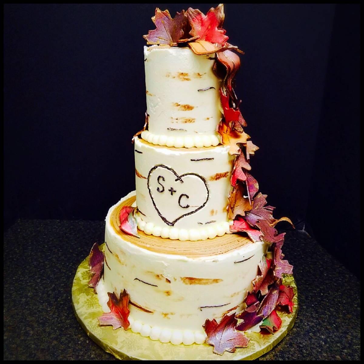 Naked Cake w/ a Cascade of Flowers