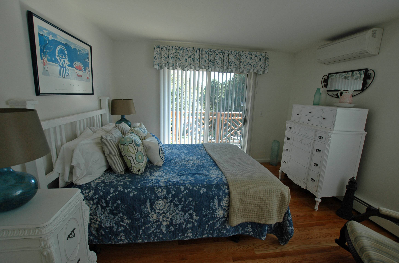 Blue queen-sized bedroom.