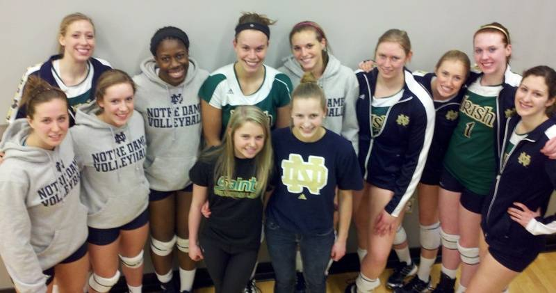 ND players with two of our Saints