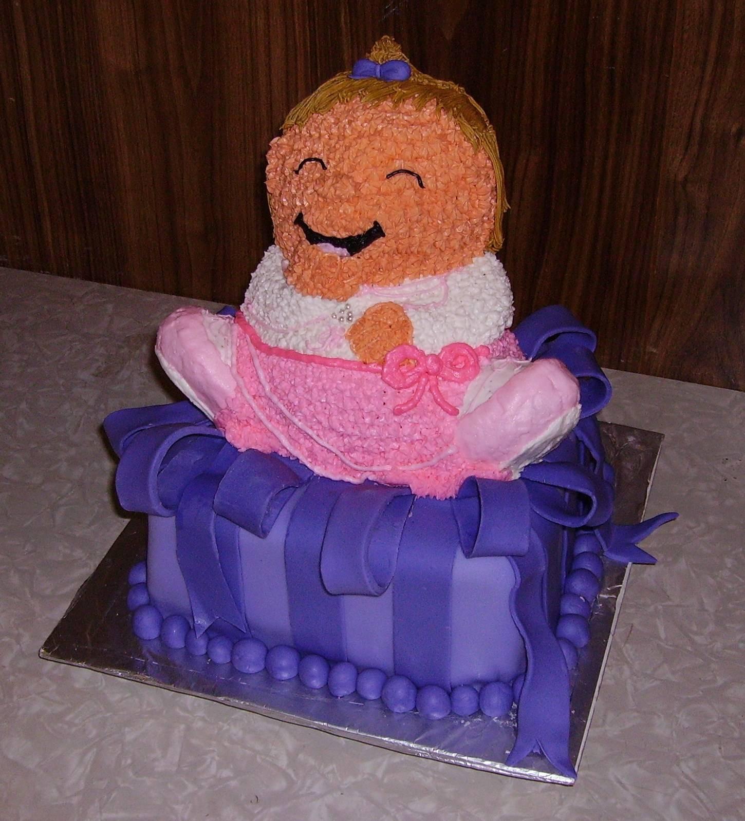 Little Girl on Present Cake