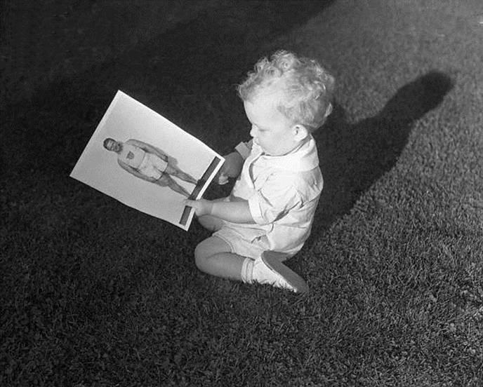 Charley Jr. Looking at his Dad's Photo