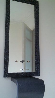Mirror framed with faucet holes