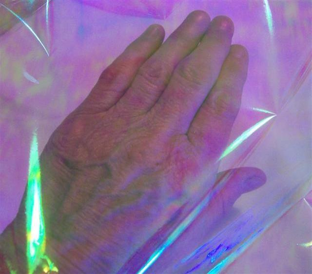 Opal  laid over a hand