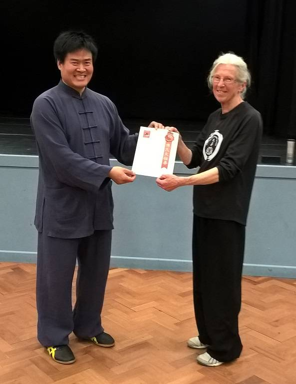 Pat recceives her Teachers Certificate from Master Wang