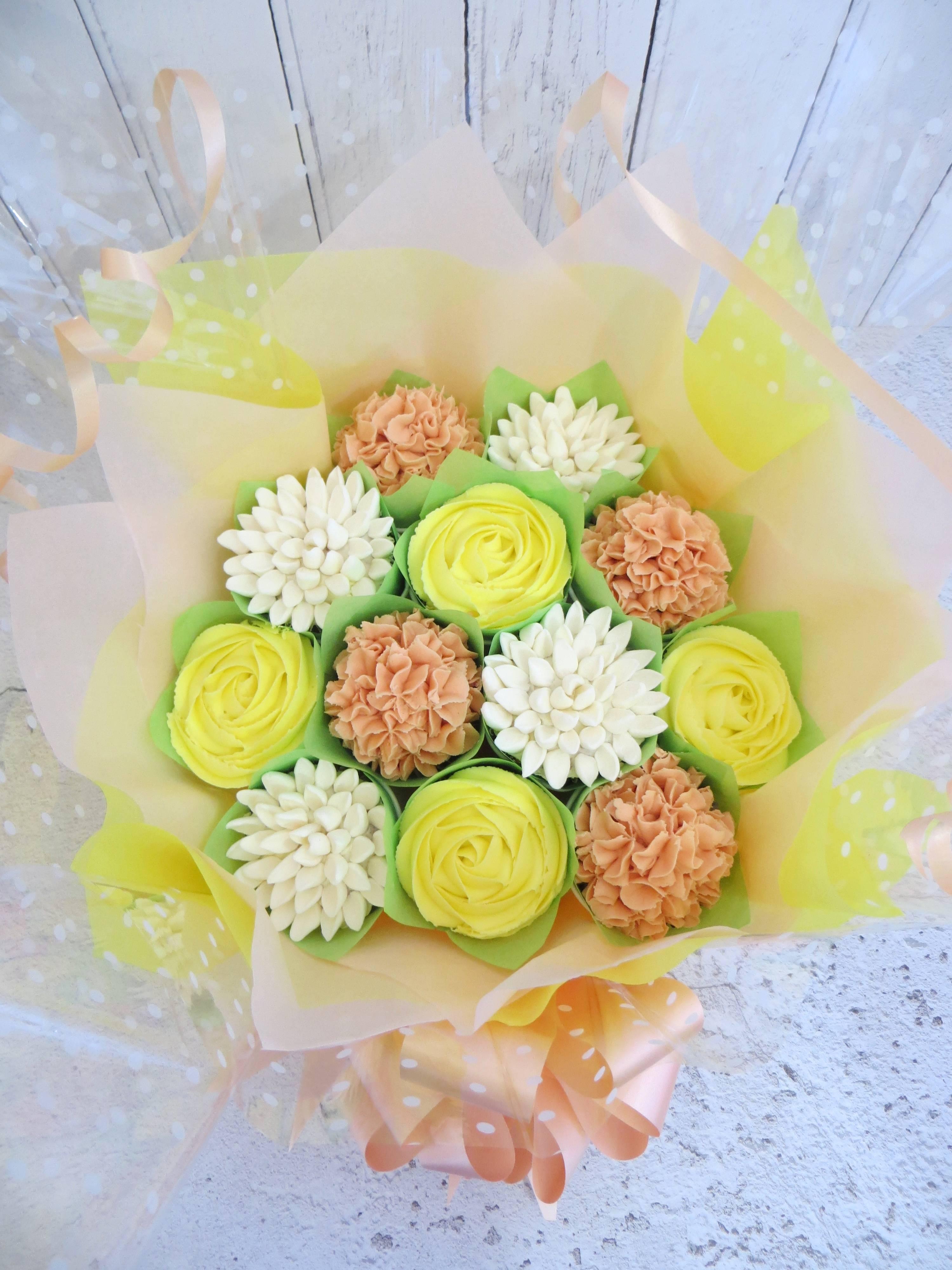 Yellow, white and orange cupcake bouquet