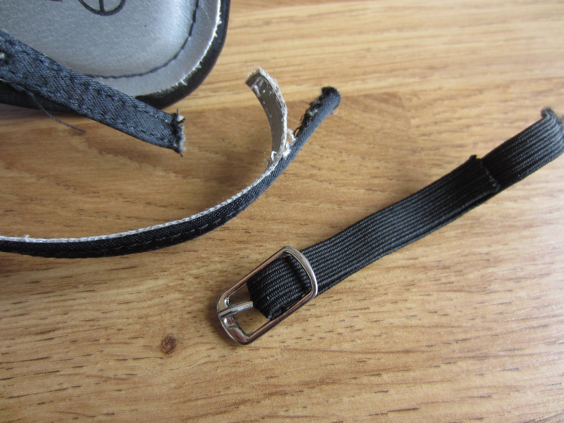 Fit new elastic to buckle.
