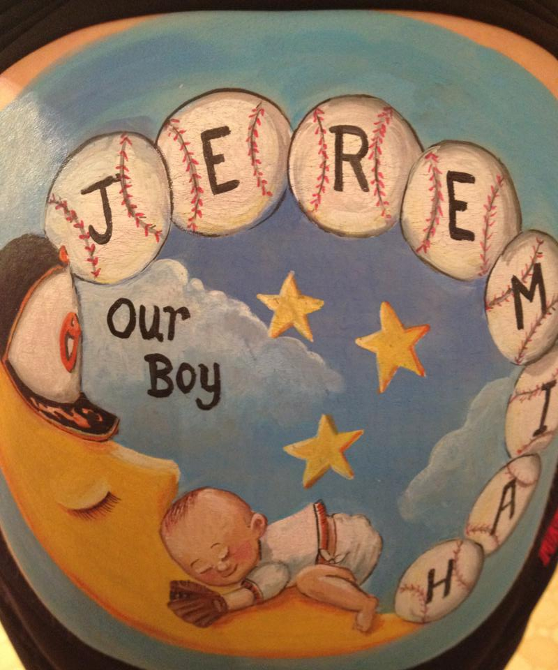 Baseball theme baby belly painting