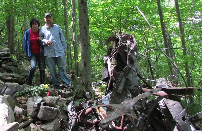 Mark Avery escorting Linda to place flowers near the wreckage.