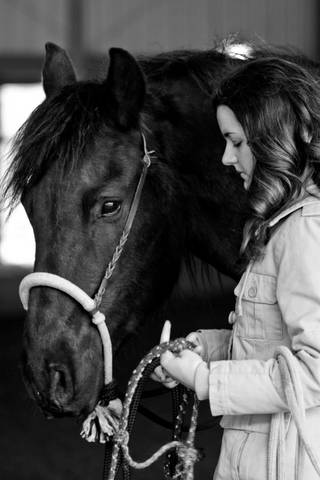Carrie and her Fresian gelding