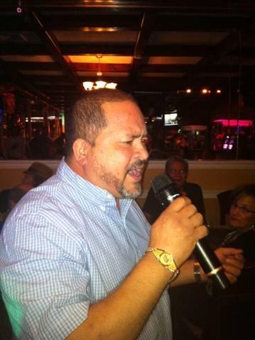 Benjamin Sr. singing for the crowd at Joe's Place Friday Night Karaoke Fiesta!
