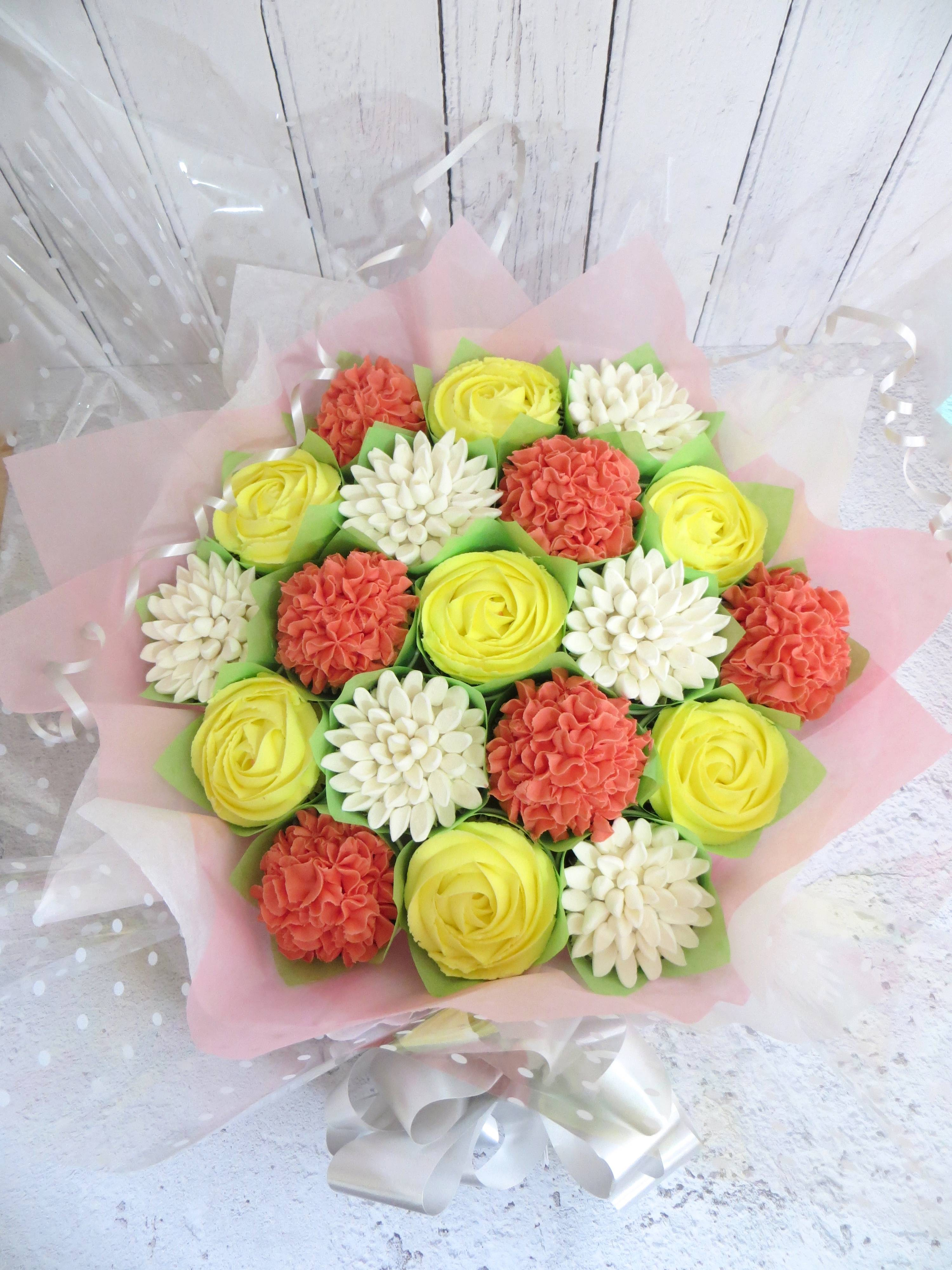 White, yellow and coral cupcake bouquet