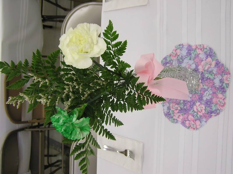 Flower vases on doilies from P&S quilters.