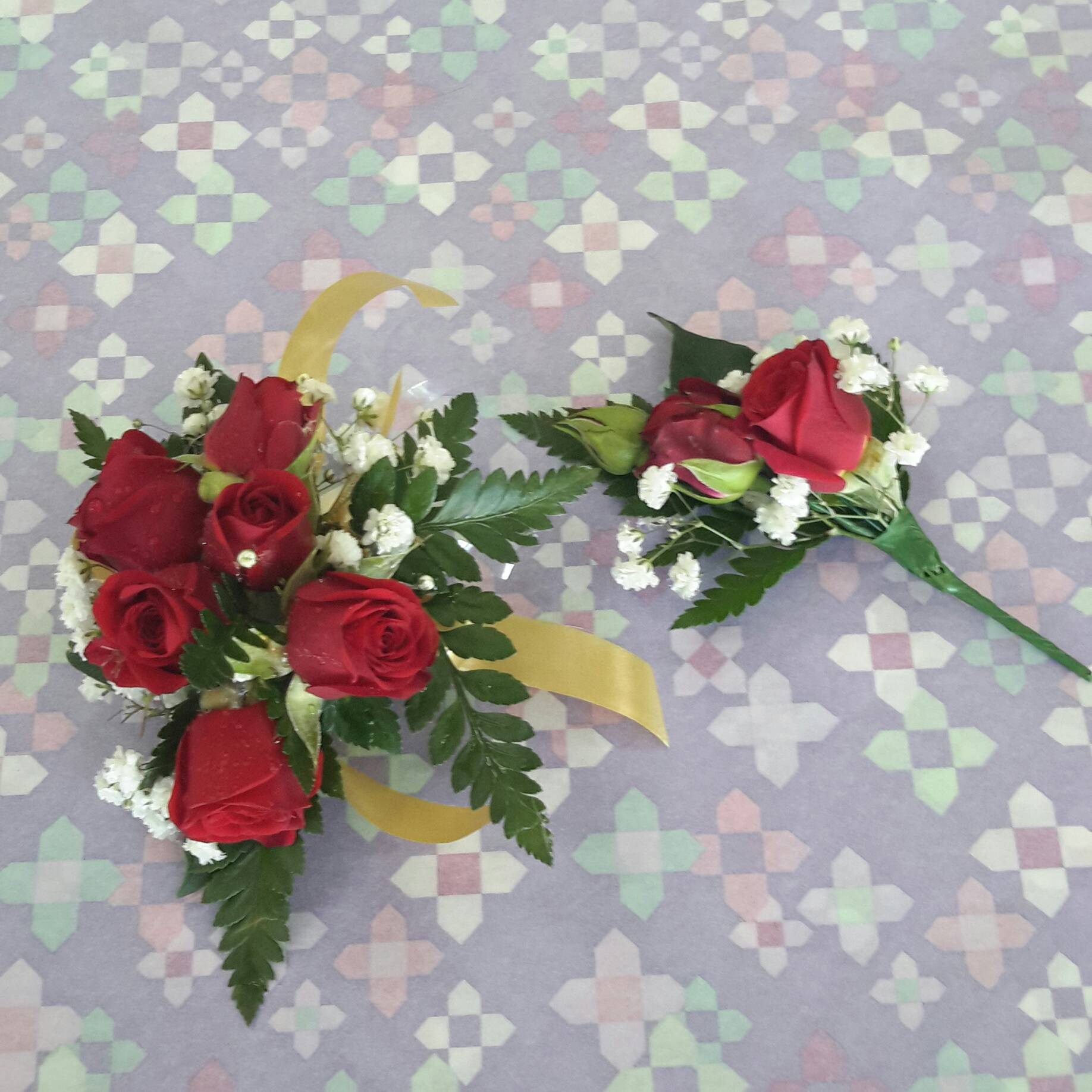 Red roses corage and matching button hole