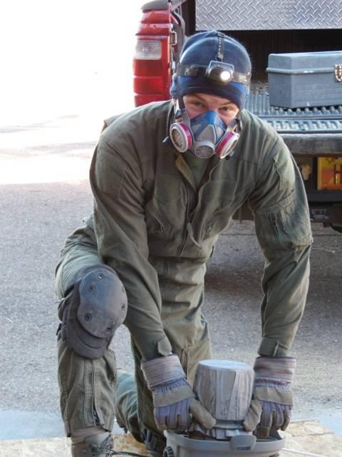 James preparing to vacuum ceiling dust