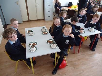 Pupils enjoying Fairtrade hot chocolate and Fairtrade cookies!