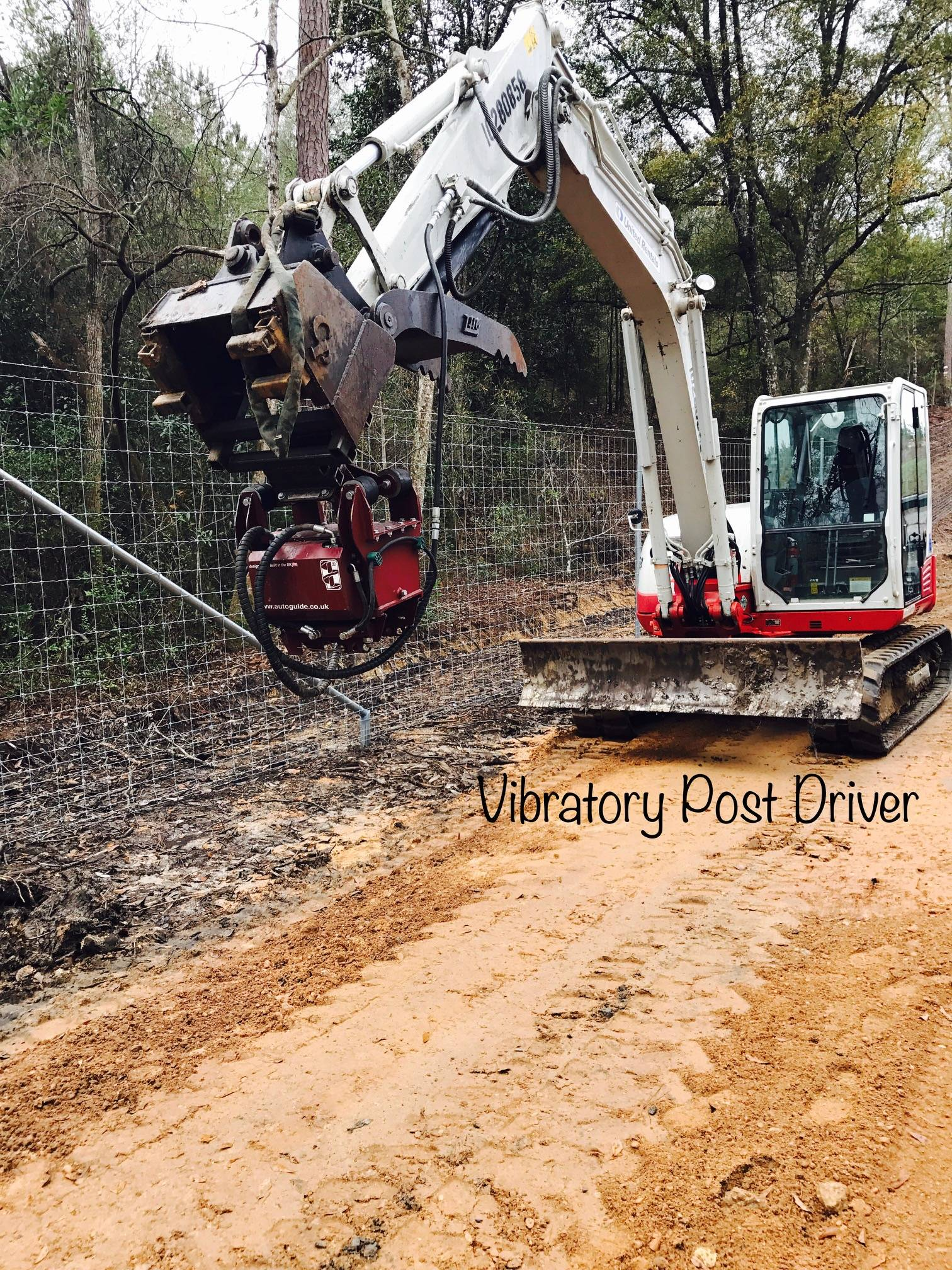 Takeuchi TB285 Mini-Ex with vibratory driver.
