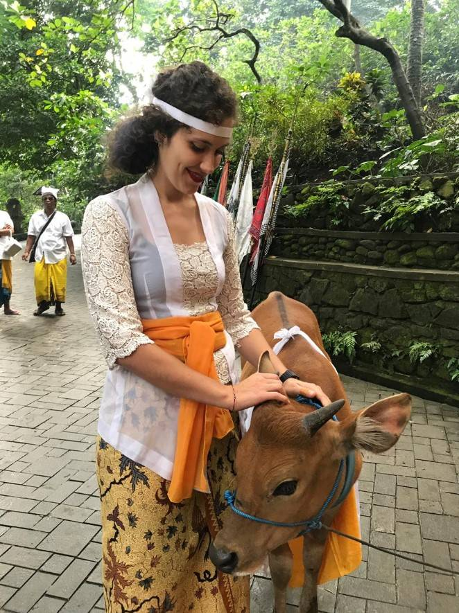 """Camilla Cenni and a cow during the """"once every 100 year"""" ceremony (Ubud Monkey Forest, Bali, July 2019)"""
