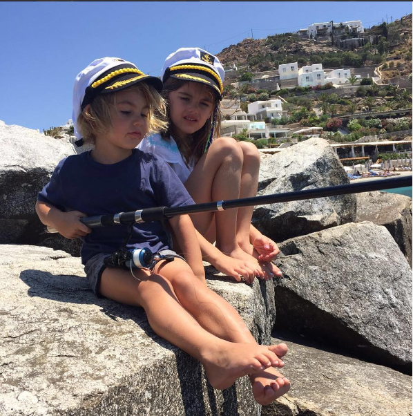 Ambrosio's kids in hats while fishing on a Mykonos rock