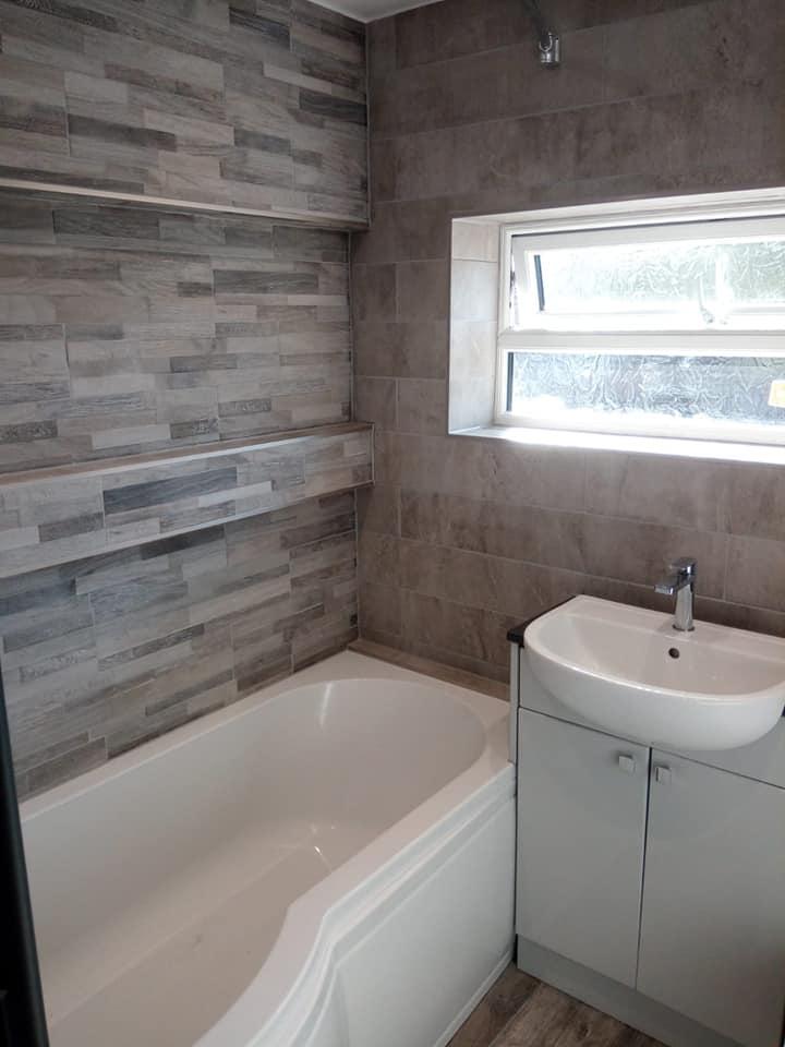 Tiled master bathroom.