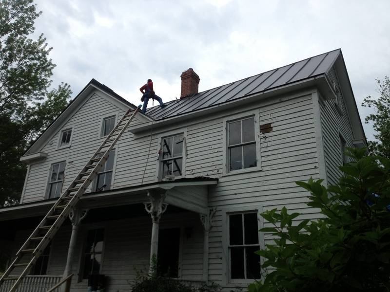 New Metal Roof and Chimney Point up