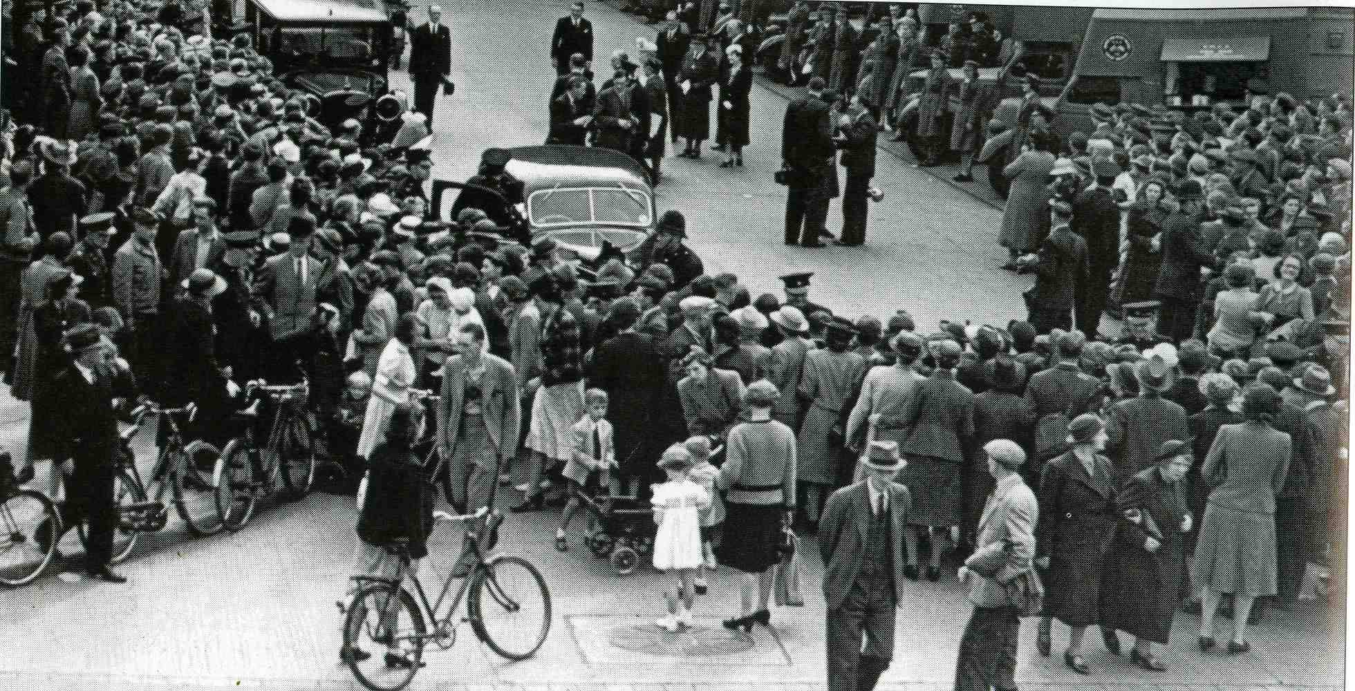 Crowds come to see the inspection by Queen Mary.