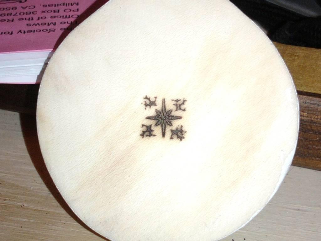 carved medallion back showing maker's mark