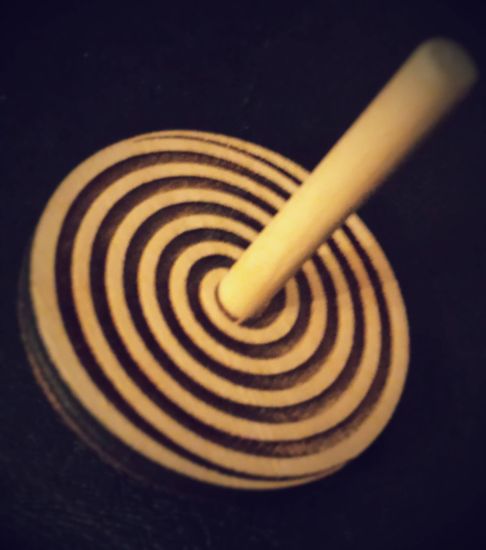 Laser Spin Top