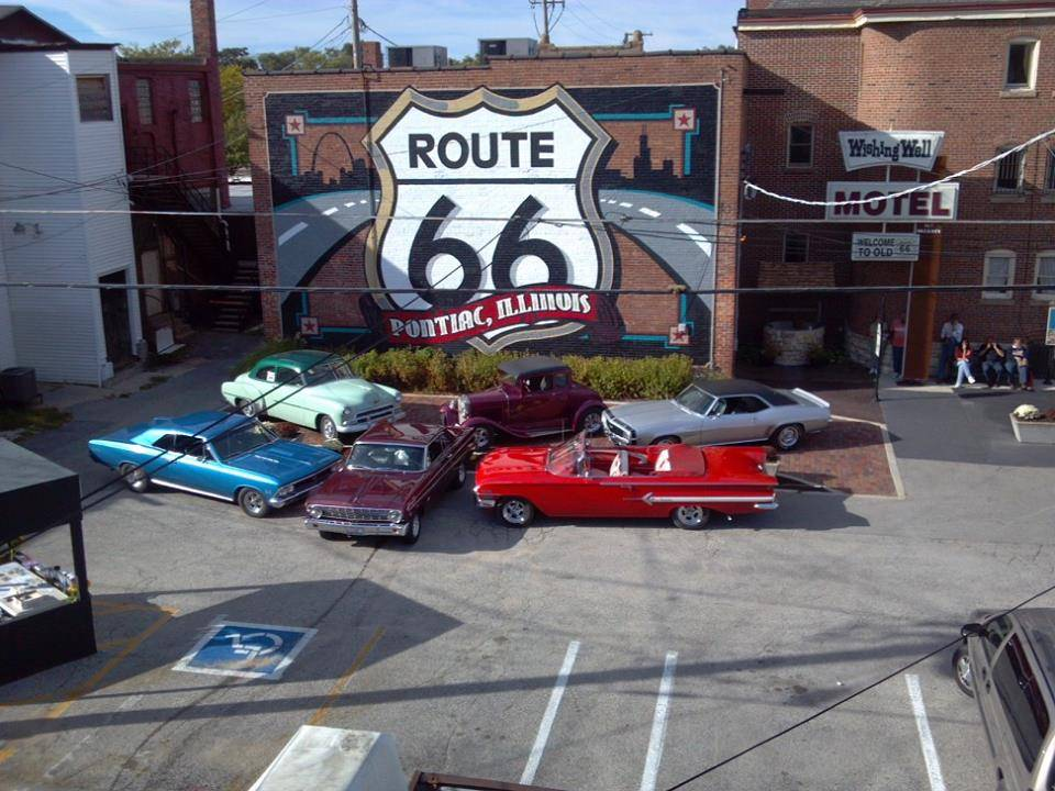 Gentlemen Club cars in front of '66 mural