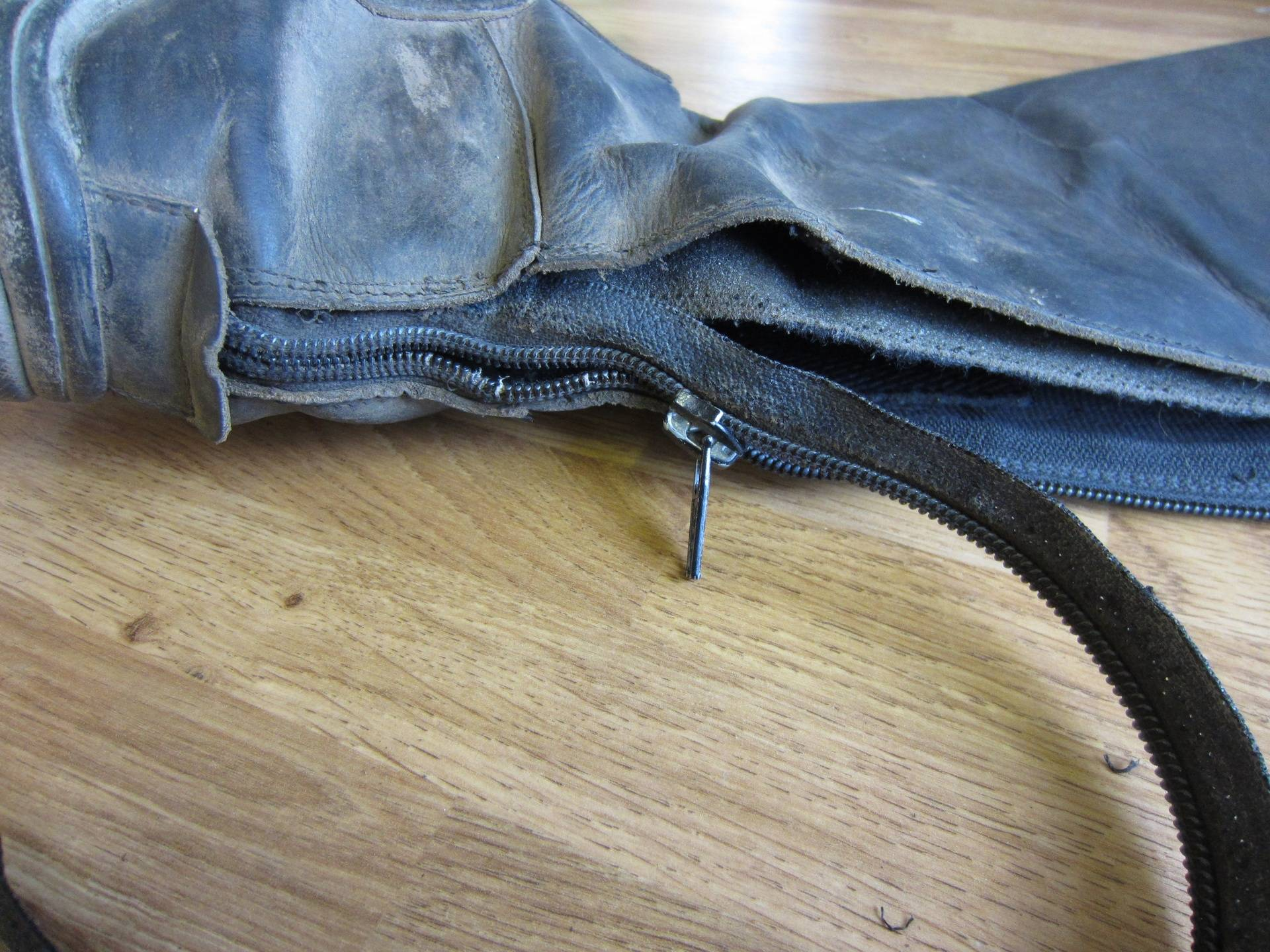 Cut stitching to relese zip out of boot